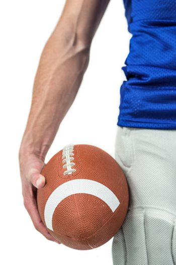 Midsection of sports player holding ball