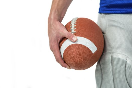 Close-up of sports player holding ball