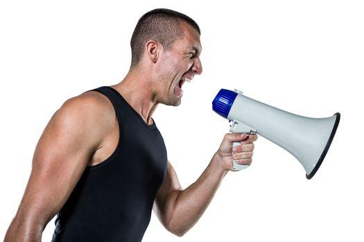 Irritated male trainer yelling through megaphone