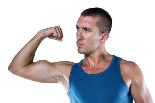Handsome man flexing muscles