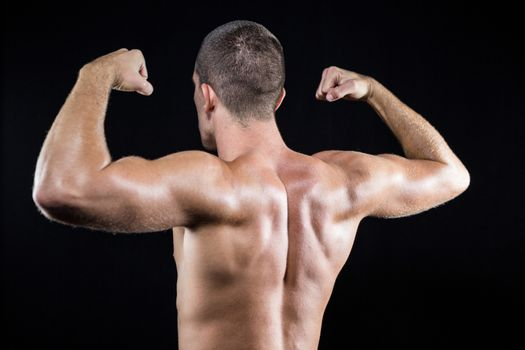 Shirtless athlete flexing muscles