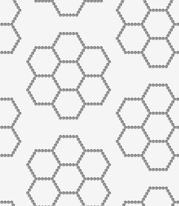 Perforated paper with hexagons forming flowers