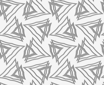Perforated paper with overlapping triangles