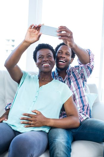 Smiling couple clicking selfie