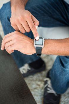 Man touching on smart watch