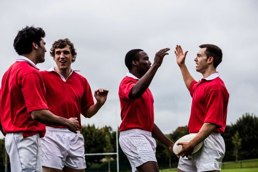 Rugby players celebrating a win