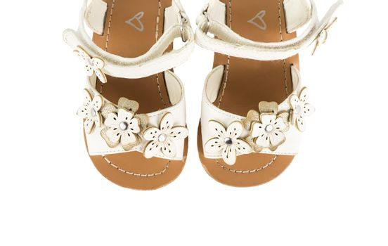 leather white baby girl summer sandals isolated on a white background, top view