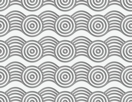 Perforated circles on bulging ribbon