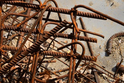 Rusty corroded stained metal pieces: wire, fitting, armature on