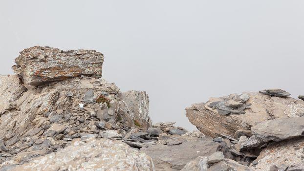Large boulders in fog