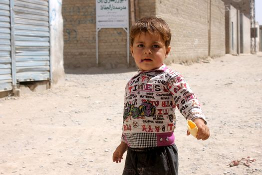 AFGHANISTAN, Kandahar: Tens of thousands of children in Kandahar don't attend school, due to a shortage of teachers and school buildings, the cost of schooling, and the cultural beliefs around education for girls. These photos capture children not in school who play on the streets or care for siblings, as well as some of the lucky ones who are being educated. Pictures taken on September 11, 2015. All children have parental permission to be photographed.