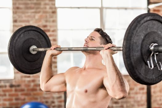 Muscular man doing weightlifting in crossfit
