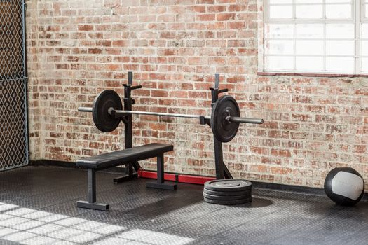 A barbell next to weights