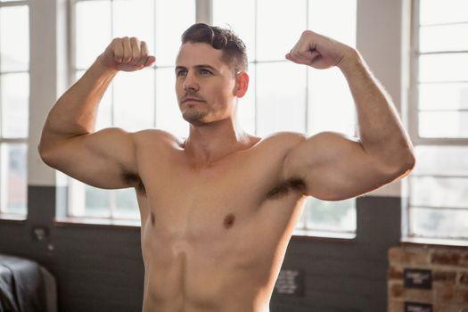 Muscular man flexing muscles