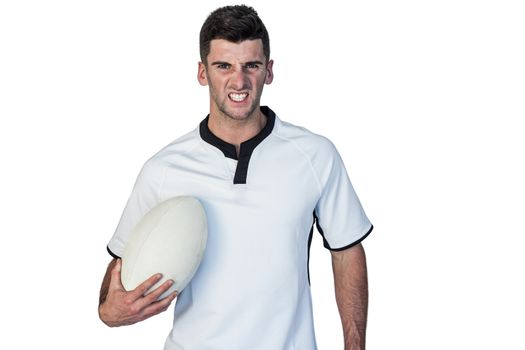Portrait of an irritated rugby holding ball