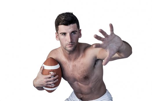 Shirtless rugby player defending
