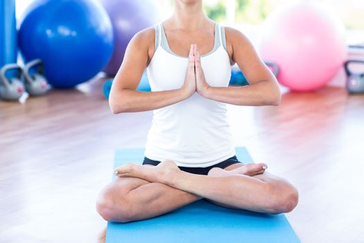Woman doing lotus posture with hands joined