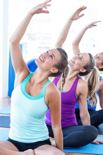 Cheerful women in easy pose with hands raised