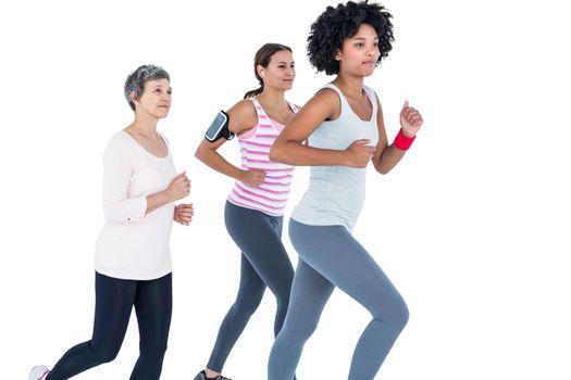 Determined female friends jogging