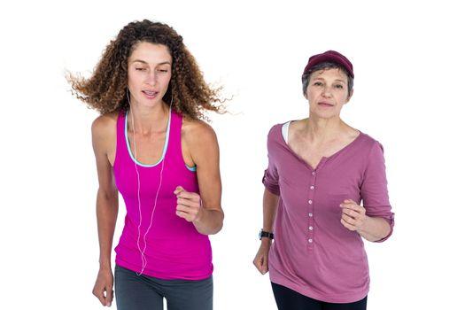 Determined women jogging