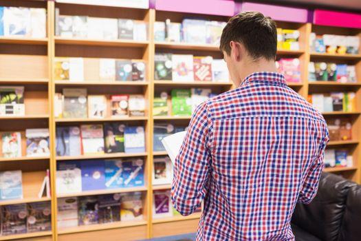 Man standing in front of bookshelf