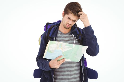 Man scratching head looking in map