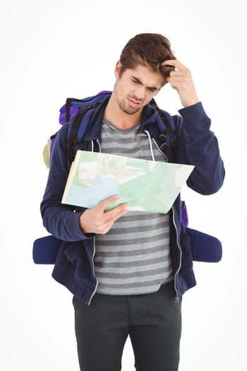 Man scratching head while looking in map