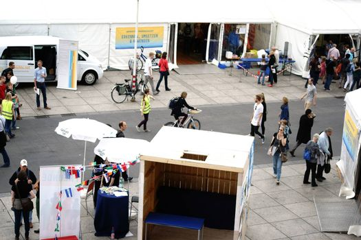 Mainz, Germany - September 11, 2015: Group of people and visitors going and talking at the stands of the Science Days Mainz on September 11, 2015 in Mainz.