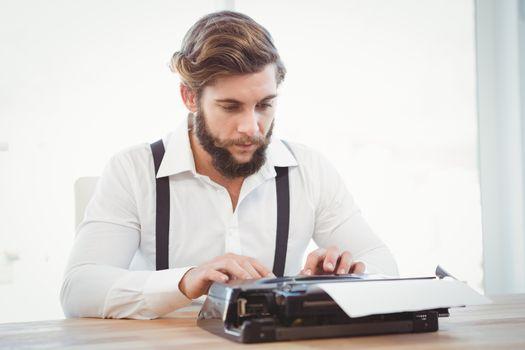 Hipster working on typewriter