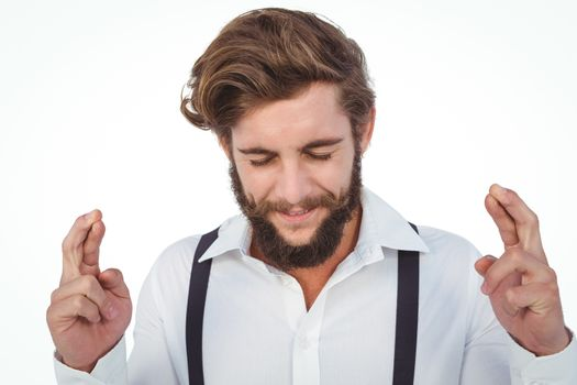 Hipster with fingers crossed