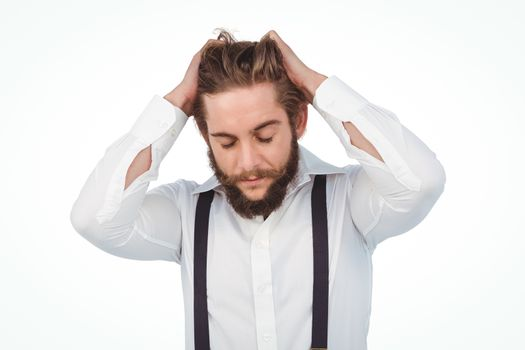 Frustrated hipster with head in hands