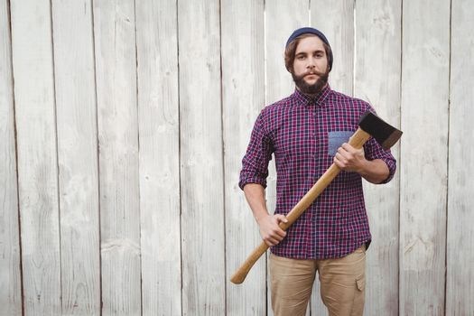 Portrait of hipster with axe