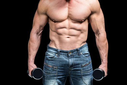 Midsection of bodybuilder with dumbbells