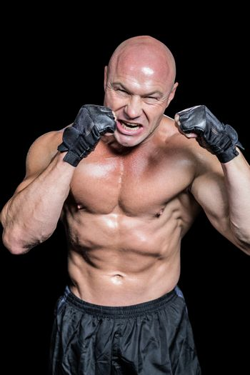 Angry bald fighter with gloves