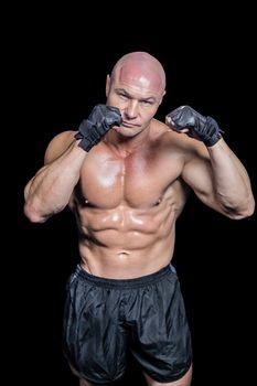 Portrait of bald muscular man