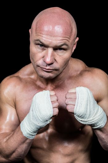Portrait of bald fighter with bandage