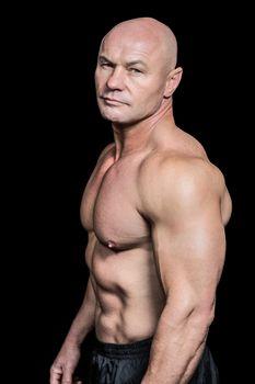 Portrait of shirtless bald man