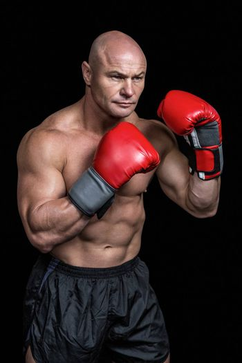 Bald boxer with red gloves
