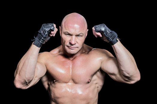 Portrait of bald man in gloves