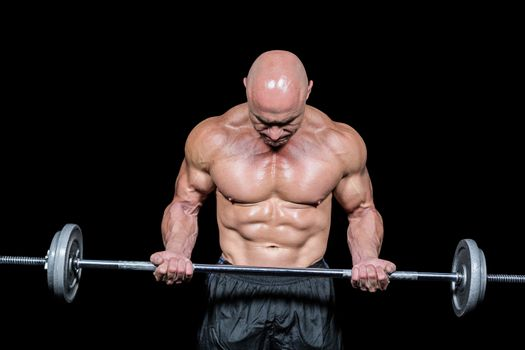 Bodybuilder exercising with crossfit