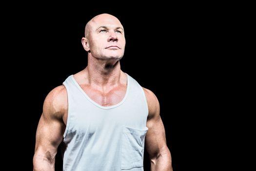 Bodybuilder in vest looking up