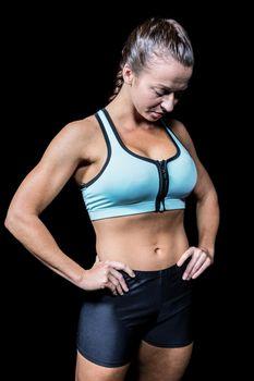 Woman in sportswear looking down