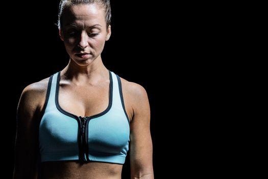 Worried woman in sportswear
