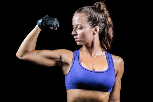 Confident woman flexing muscles