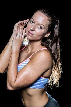 Seductive bodybuilder against black background