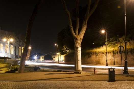 street in Rome at night with light trails