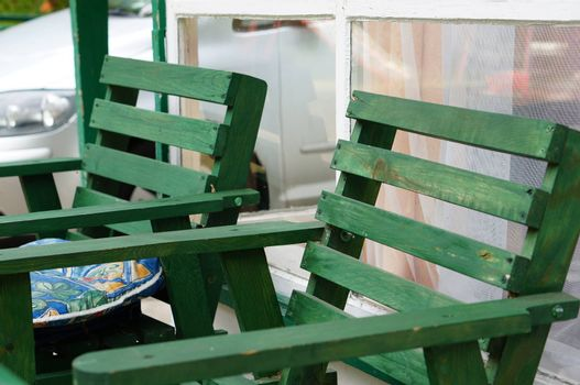 Close up of two wooden garden chairs