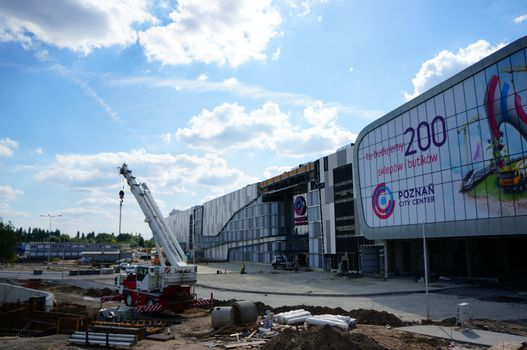 POZNAN, POLAND - AUGUST 25, 2013: Construction in front of the new shopping mall Poznan City Center