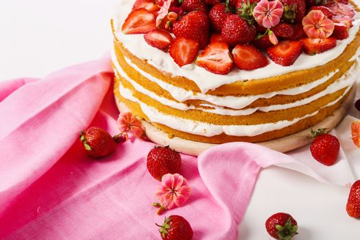 Layered, strawberry cake on the table