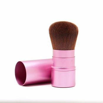cosmetic blusher brush on white background